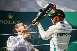 Lewis Hamilton, Mercedes AMG F1 celebrates by spraying champagne with Mercedes AMG F! Team Member