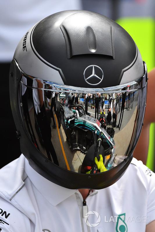McLaren mechanic with reflection in helmet