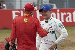 Le poleman Sebastian Vettel, Ferrari, et Valtteri Bottas, Mercedes AMG F1
