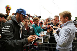 Lewis Hamilton, Mercedes AMG F1 and team mate Nico Rosberg, Mercedes AMG F1 sign autographs for the