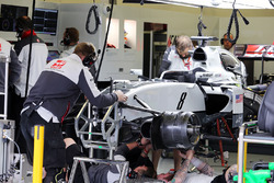 The Haas VF-16 of Romain Grosjean, Haas F1 Team is worked on in the second practice session