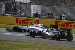 Felipe Massa, Williams Martini Racing FW38 leads Sergio Perez, Force India F1 VJM09
