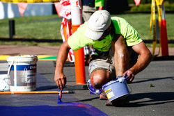 Touching up the paint on the track