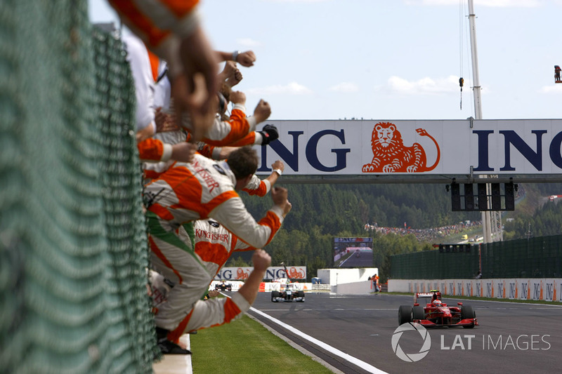 Kimi Raikkonen, Ferrari F60 crosses the line to win the race as the Force India team cheer Giancarlo Fisichella, Force India VJM02 Mercedes in second place