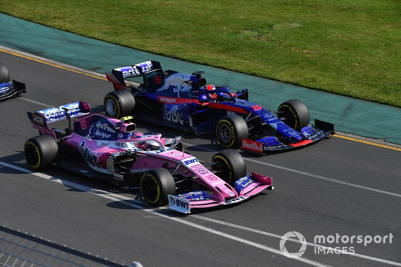 Lance Stroll, Racing Point RP19, battles with Daniil Kvyat, Toro Rosso STR14, at the start