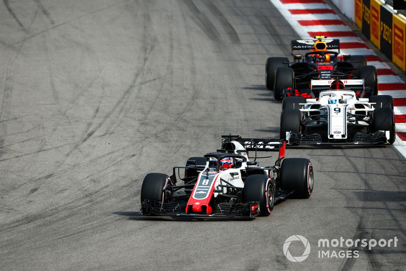 Romain Grosjean, Haas F1 Team VF-18, leads Marcus Ericsson, Sauber C37, and Max Verstappen, Red Bull Racing RB14