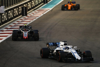 Lance Stroll, Williams FW41, leads Kevin Magnussen, Haas F1 Team VF-18, and Stoffel Vandoorne, McLaren MCL33