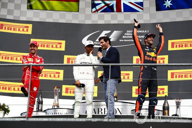 Podium: Mark Webber, Channel 4 F1, interviews Race winner Lewis Hamilton, Mercedes AMG F1, Sebastian Vettel, Ferrari and Daniel Ricciardo, Red Bull Racing
