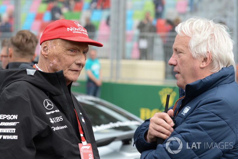 Niki Lauda, Mercedes AMG F1 Non-Executive Chairman and Charlie Whiting, FIA Delegate on the grid