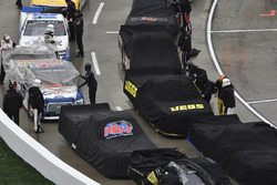 Noah Gragson, Kyle Busch Motorsports, Toyota Tundra Safelite, Cody Coughlin, GMS Racing, Chevrolet Silverado Jeg's.com crews cover the trucks during a rain delay