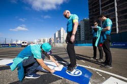 Luca Filippi, NIO Formula E Team, takes notes on a kerb