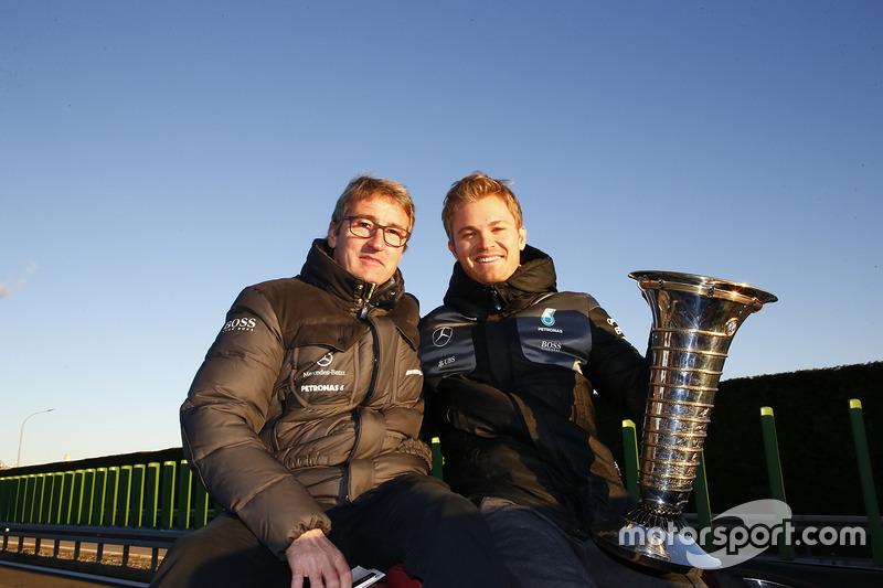 World Champion Nico Rosberg celebrates with Bernd Schneider