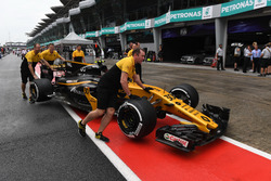 The car of Jolyon Palmer, Renault Sport F1 Team RS17 is pushed by mechanics in pitlane