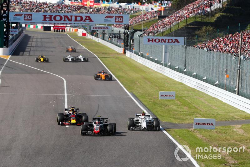 Kevin Magnussen, Haas F1 Team VF-18, batalla con Charles Leclerc, Sauber C37, y Daniel Ricciardo, Red Bull Racing RB14