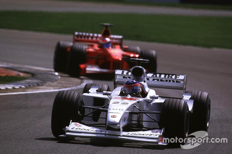 Jacques Villeneuve, BAR leads Michael Schumacher, Ferrari