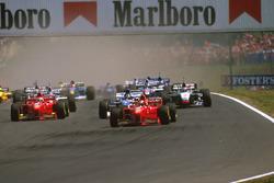 Michael Schumacher, Ferrari F310B, Damon Hill Arrows A18 , Eddie Irvine, Ferrari F310B