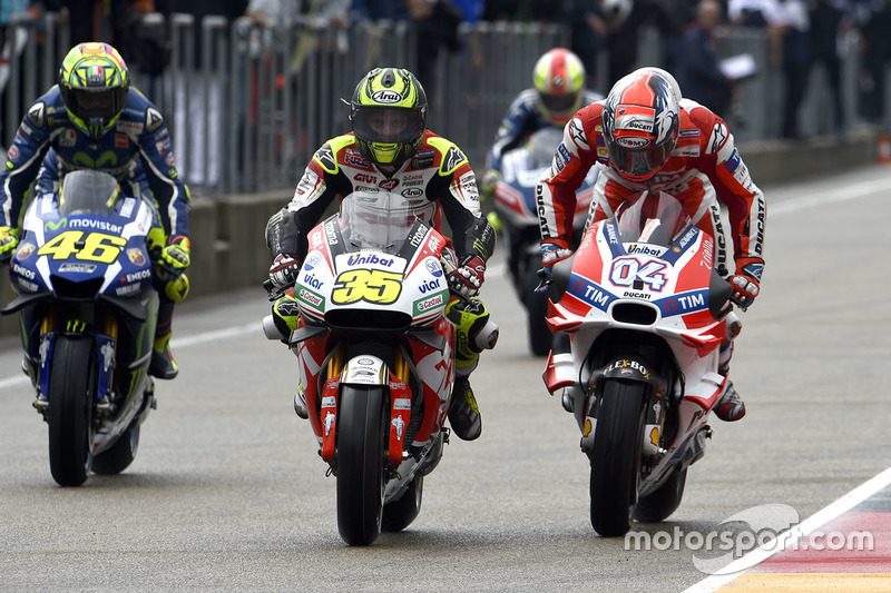 Cal Crutchlow, Team LCR Honda, Andrea Dovizioso, Ducati Team and Valentino Rossi, Yamaha Factory Racing in the pitlane