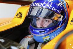 Fernando Alonso, McLaren, in cockpit with helmet visor raised