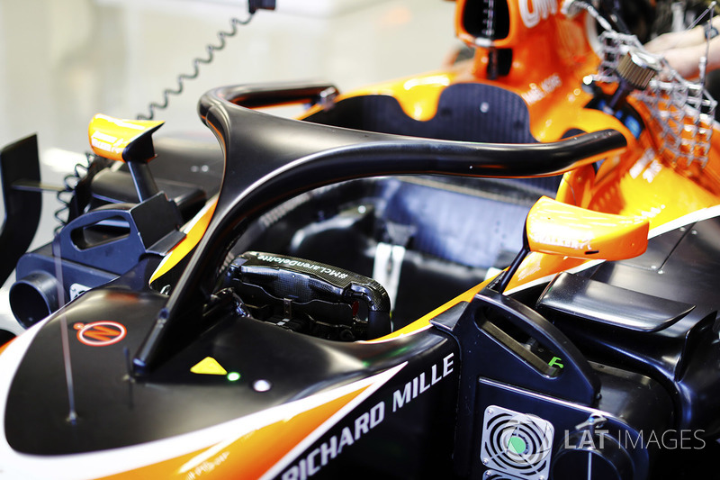 The halo device is fitted to the cockpit of a McLaren MCL32