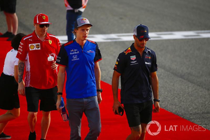 Kimi Raikkonen, Ferrari, Brendon Hartley, Toro Rosso, and Daniel Ricciardo, Red Bull Racing, in the drivers parade