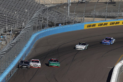 Christopher Bell, Joe Gibbs Racing Toyota, Cole Custer, Stewart-Haas Racing Ford, three-wide