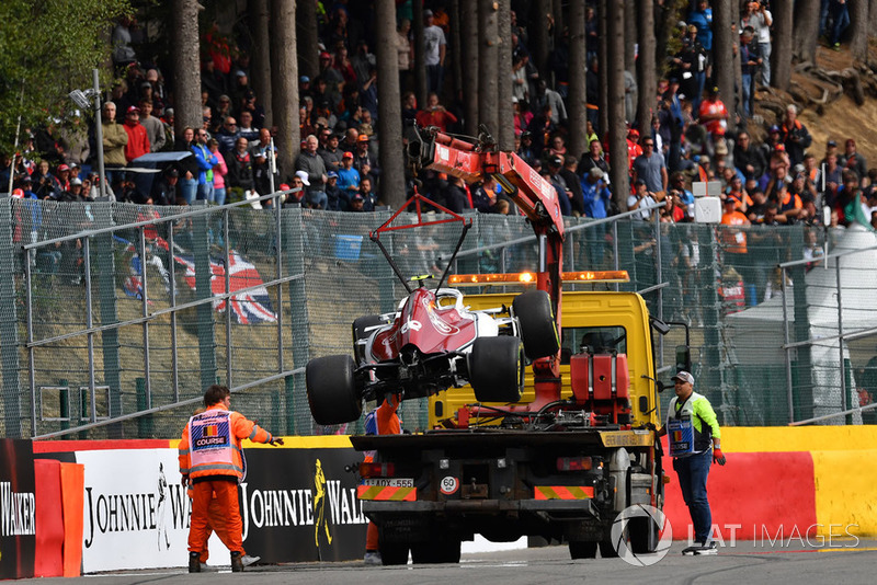 The crashed car of Charles Leclerc, Sauber C37 is recovered