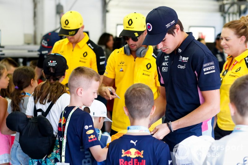 Lance Stroll, Racing Point, Daniel Ricciardo, Renault F1 Team and Nico Hulkenberg, Renault F1 Team sign autographs for Grid Kids