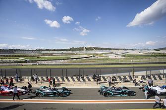 Mitch Evans, Panasonic Jaguar Racing, Jaguar I-Type 3 and Nelson Piquet Jr., Panasonic Jaguar Racing, I-Type 3 leave the pit lane