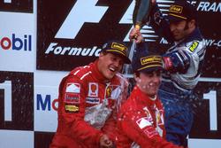 Podium: Race winner Michael Schumacher, Ferrari, second place Heinz-Harald Frentzen, Williams, third