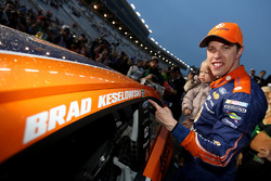 Brad Keselowski, Team Penske Ford, affixes the winners decal to his car in Victory Lane after winning
