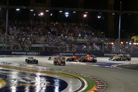 Sebastian Vettel, Ferrari SF70H leads as Max Verstappen, Red Bull Racing RB13 and Kimi Raikkonen, Ferrari SF70H crash at the start of the race