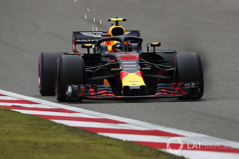 Max Verstappen, Red Bull Racing RB14 Tag Heuer, strikes up sparks as brake dust pours from his front
