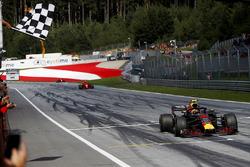 Max Verstappen, Red Bull Racing RB14, takes the chequered flag ahead of Kimi Raikkonen, Ferrari SF71H, and Sebastian Vettel, Ferrari SF71H