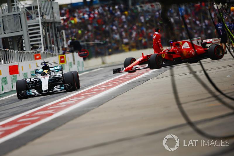 Lewis Hamilton, Mercedes AMG F1 W08, Sebastian Vettel, Ferrari SF70H, in the pit lane