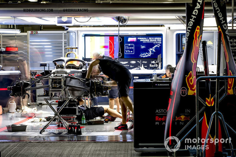 Engineers work on the car of Daniel Ricciardo, Red Bull Racing RB14, in the garage