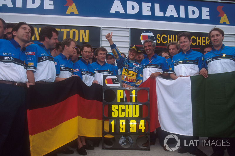 Michael Schumacher celebrates becoming World Champion with Flavio Briatore, Tom Walkinshaw and the rest of the team