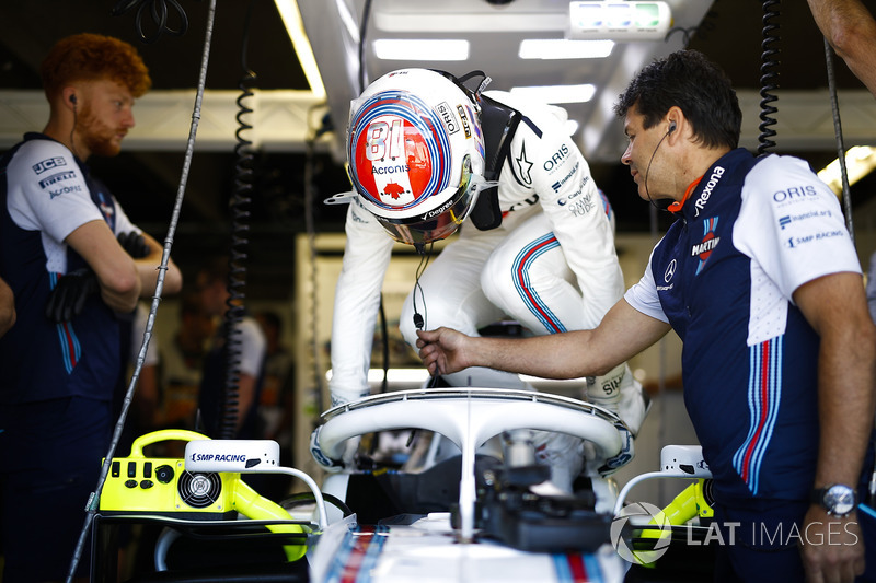 Lance Stroll, Williams Racing, enters his cockpit.
