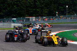 Kevin Magnussen, Renault Sport F1 Team RS16 leads Jenson Button, McLaren MP4-31 as he is hit by Pasc