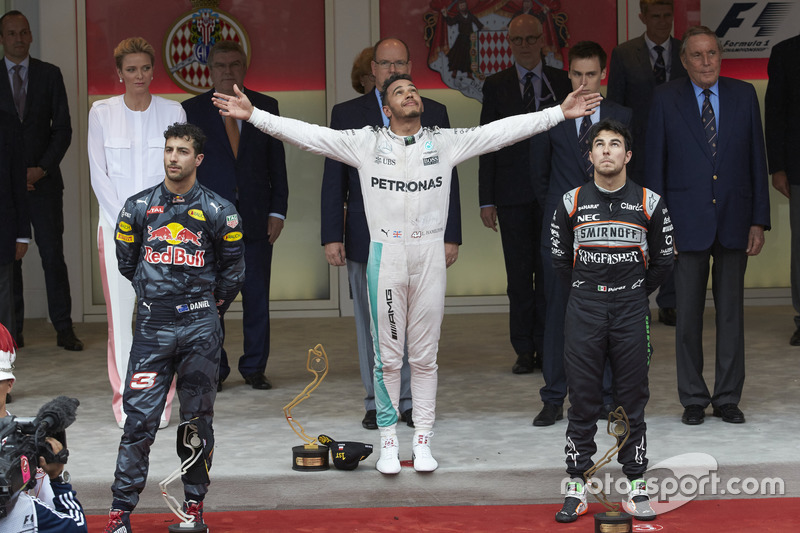 The podium, Red Bull Racing, second; Lewis Hamilton, Mercedes AMG F1, race winner; Sergio Perez, Sahara Force India F1, third