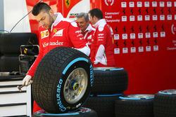 Ferrari mechanic with a Pirelli tyre