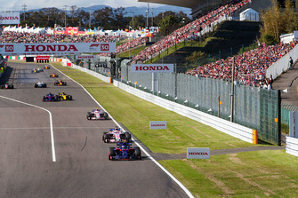 Pierre Gasly, Scuderia Toro Rosso STR13,leads Sergio Perez, Racing Point Force India VJM11, and Esteban Ocon, Racing Point Force India VJM11