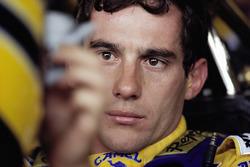 Ayrton Senna strapped to his Lotus cockpit