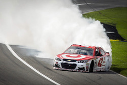 Kyle Larson, Chip Ganassi Racing Chevrolet, celebrates his victory with a burnout
