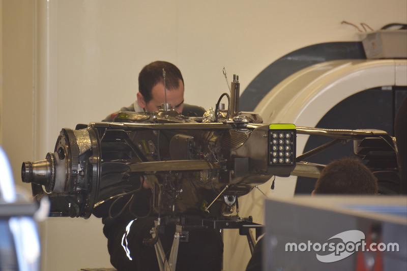 Mechanics working on the McLaren MP4-31