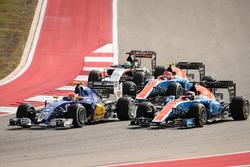 Felipe Nasr, Sauber C35 leads Pascal Wehrlein, Manor Racing MRT05; Esteban Ocon, Manor Racing MRT05 and Nico Hulkenberg, Sahara Force India F1 VJM09