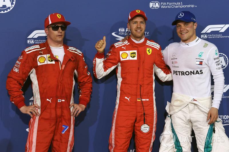 Kimi Raikkonen, Ferrari, pole sitter Sebastian Vettel, Ferrari and Valtteri Bottas, Mercedes-AMG F1