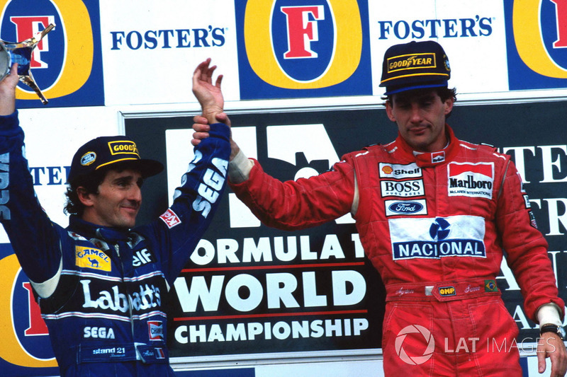 Podio: Ganador de la carrera Ayrton Senna, McLaren, segundo lugar y Campeón del mundo Alain Prost, Williams