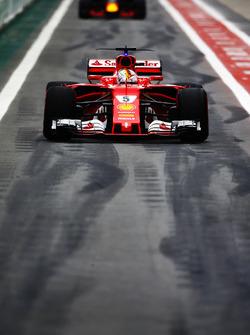 Sebastian Vettel, Ferrari SF70H, Max Verstappen, Red Bull Racing RB13, in the pits