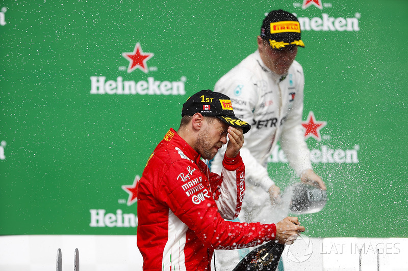 Sebastian Vettel, Ferrari, 1st position, celebrates with Champagne on the podium