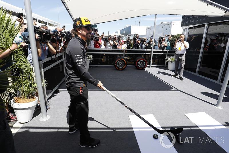 Fernando Alonso, McLaren, is filmed trying hockey